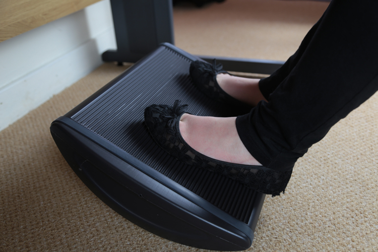 Rock the footrest to encourage movement